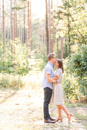 Engagement Photos Riley Trails Holland Michigan Engaged Couple kissing forehead smiling