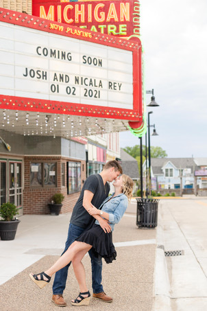 south haven man and women smiling movie theatre