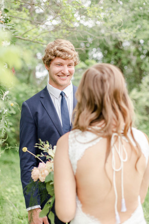 bride and groom smiling ceremony in the details byron center truer design