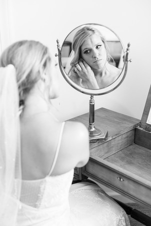 bride getting ready in mirror Kent Country Club Wedding Grand Rapids
