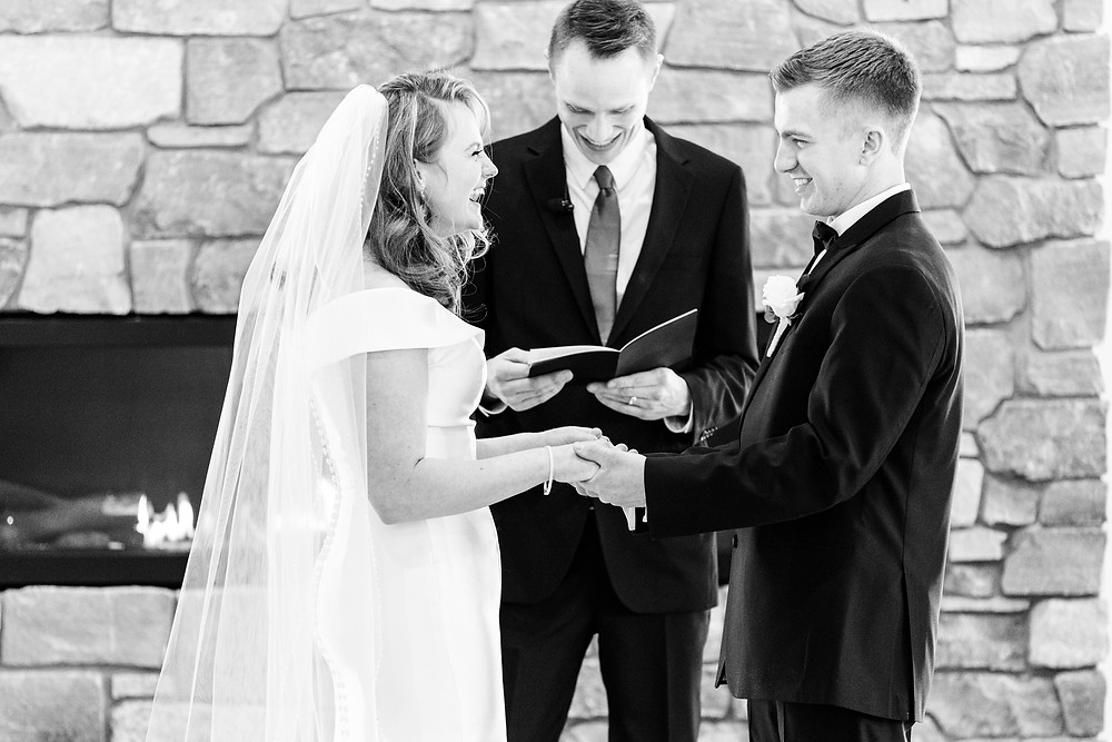 Josh and Andrea wedding photography husband and wife photographer team michigan venue Bay Pointe Woods shelbyville winter wedding ceremony bride and groom