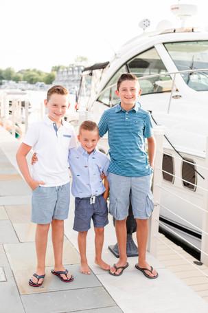 3 boys standing by yacht boat new buffalo michigan