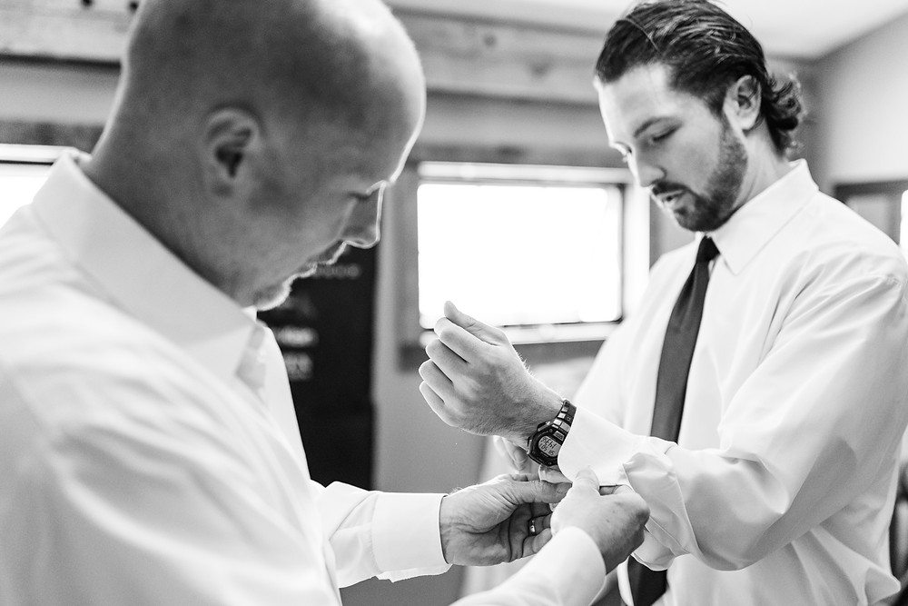 Josh and Andrea wedding photography husband and wife photographer team michigan Black Barn Wedding Venue rives junction spring groom and father of groom getting ready