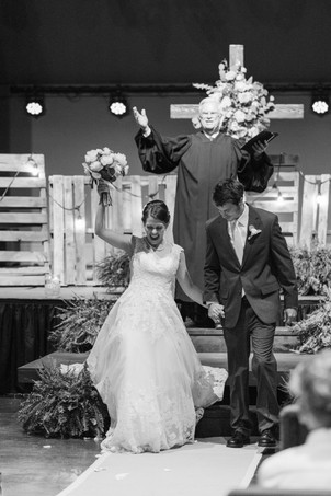 bride and groom cheering walking down aisle after ceremony Milledgeville Georgia