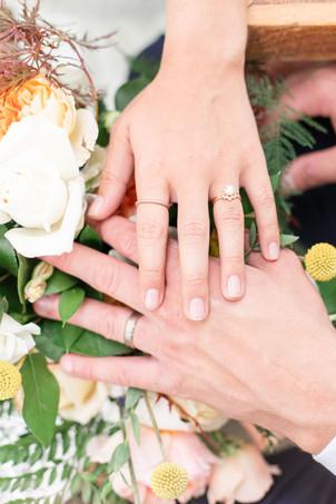 hands on flowers in the details byron center truer design
