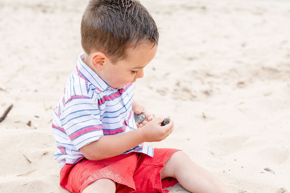 little boy playing in the sand at Lake Michigan South Haven Family Shoot
