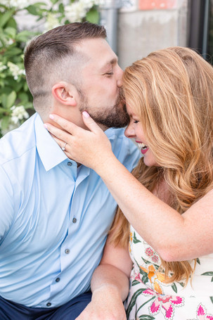 engagement photos couple kissing forehead laughing journeyman distillery weddings three oaks michigan