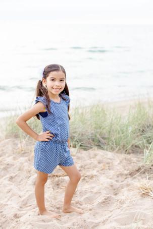 young girl standing on beach dune grass Lake Michigan South Haven Michigan