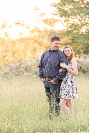 engaged couple standing open grassy field Something Blue Berry Farm Wedding Venue