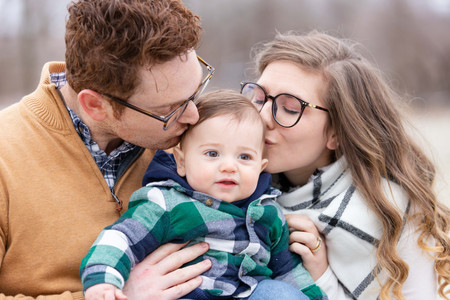family photo shoot winter south haven cute baby kissing