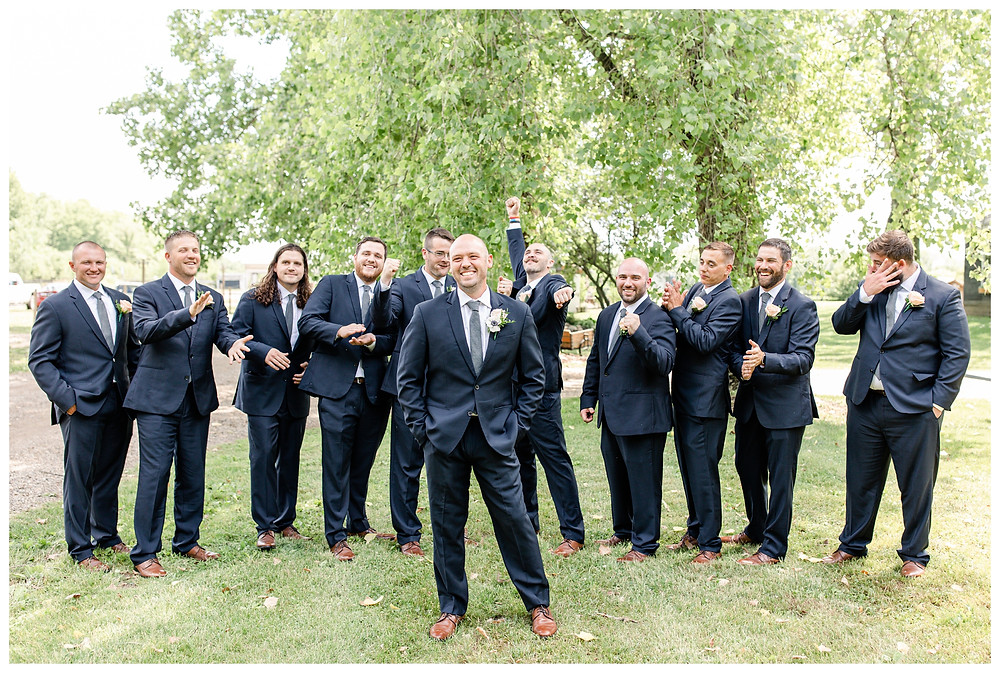 Josh and Andrea wedding photography husband and wife photographer team michigan pictures photo shoot Something Blueberry Wedding Barn farm spring groom groomsmen