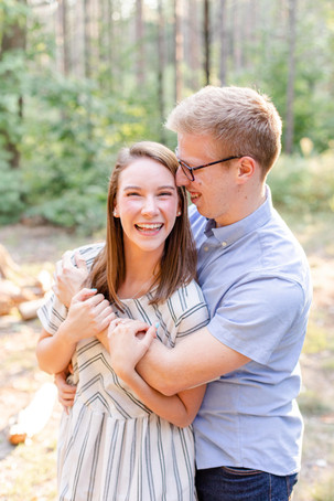 Engagement Photos Riley Trails Holland Michigan Engaged Couple hugging and laughing