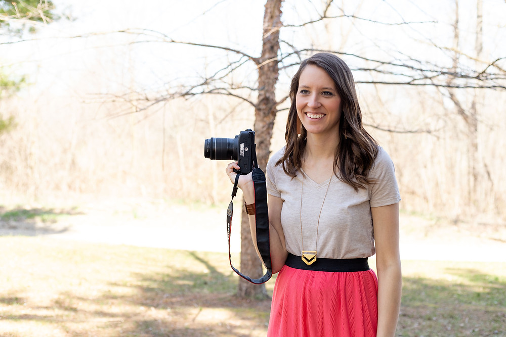 pretty woman smiling holding camera