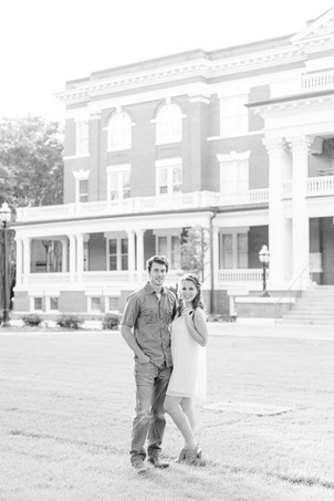 engagement photos cute couple standing in front of column building Milledgeville GA Georgia College and State University