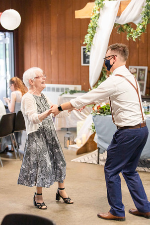Groom and grandmother smiling dancing Saint Patricks Park South Bend Indiana