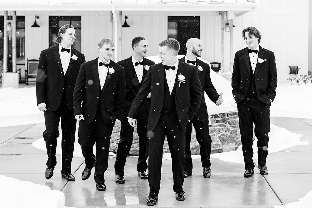 Josh and Andrea wedding photography husband and wife photographer team michigan venue Bay Pointe Woods shelbyville winter wedding groom and groomsmen black suit
