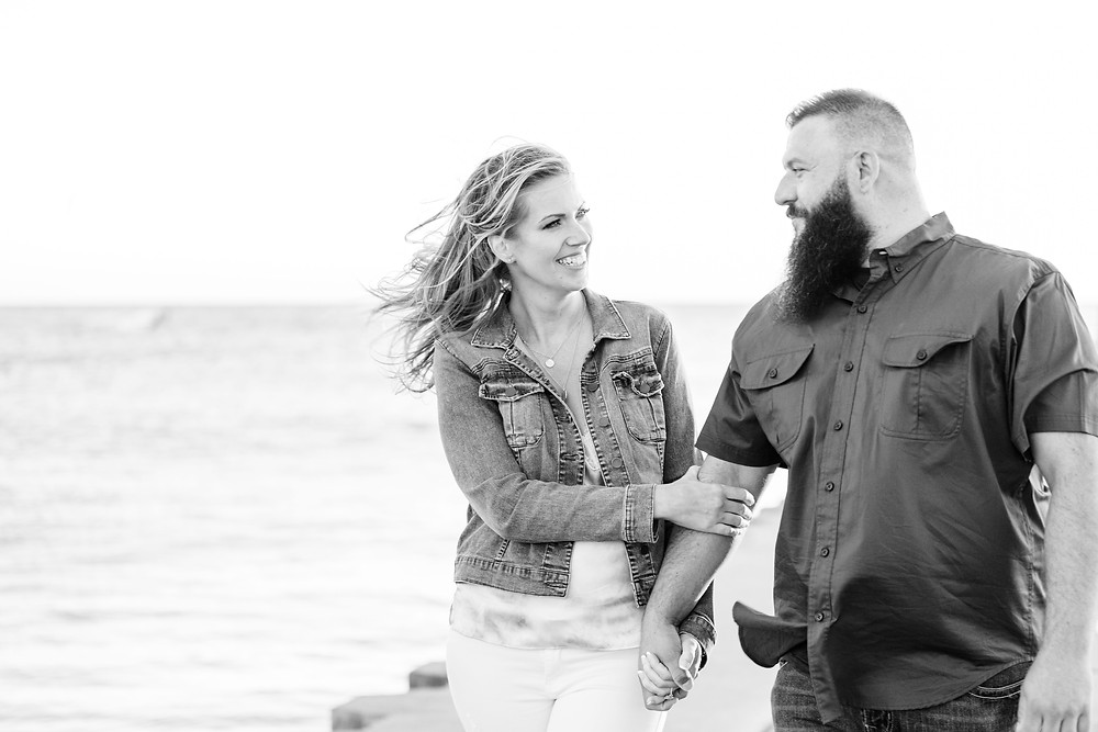 Engagement Photos Engaged Couple South Haven Beach Lighthouse Pier Michigan Engaged Couple walking on pier