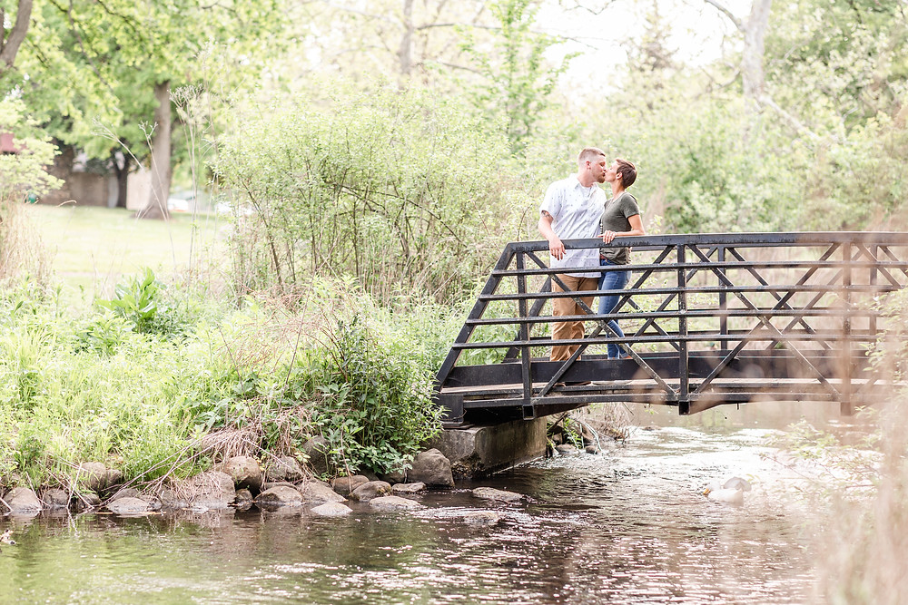 Josh and Andrea wedding photography husband and wife photographer team michigan pictures Milham Park Kalamazoo engagement pictures session photo shoot fiance bridge stream