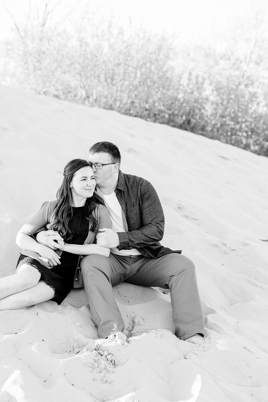 Engagement Photos Van Buren State Park Michigan Couple Sitting Snuggling on Sand Dune