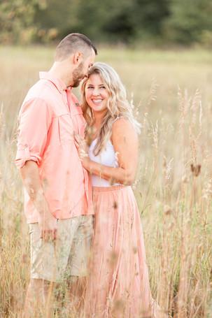 Engagement Photos Al Sabo Land Preserve Kalamazoo Michigan Open Field cute couple snuggling smiling