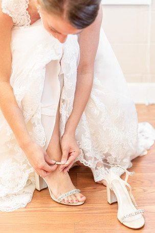 bride putting on heels shoes wedding day Milledgeville Georgia