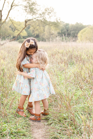 Family Photos Al Sabo Land Preserve Kalamazoo Michigan Open Field two little girls sisters hugging
