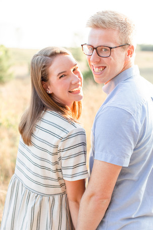 Engagement Photos Riley Trails Holland Michigan Engaged Couple smiling at camera