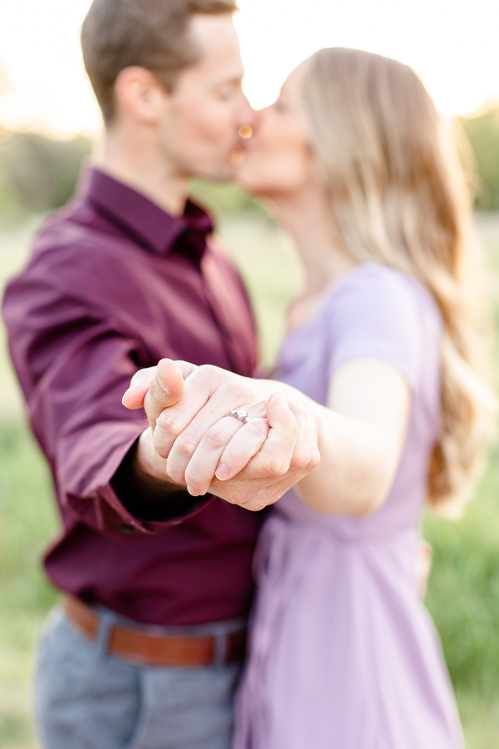 Josh and Andrea wedding photography husband and wife photographer team michigan Al Sabo Land Preserve engagement pictures session photo shoot fiance woods field kissing ring shot