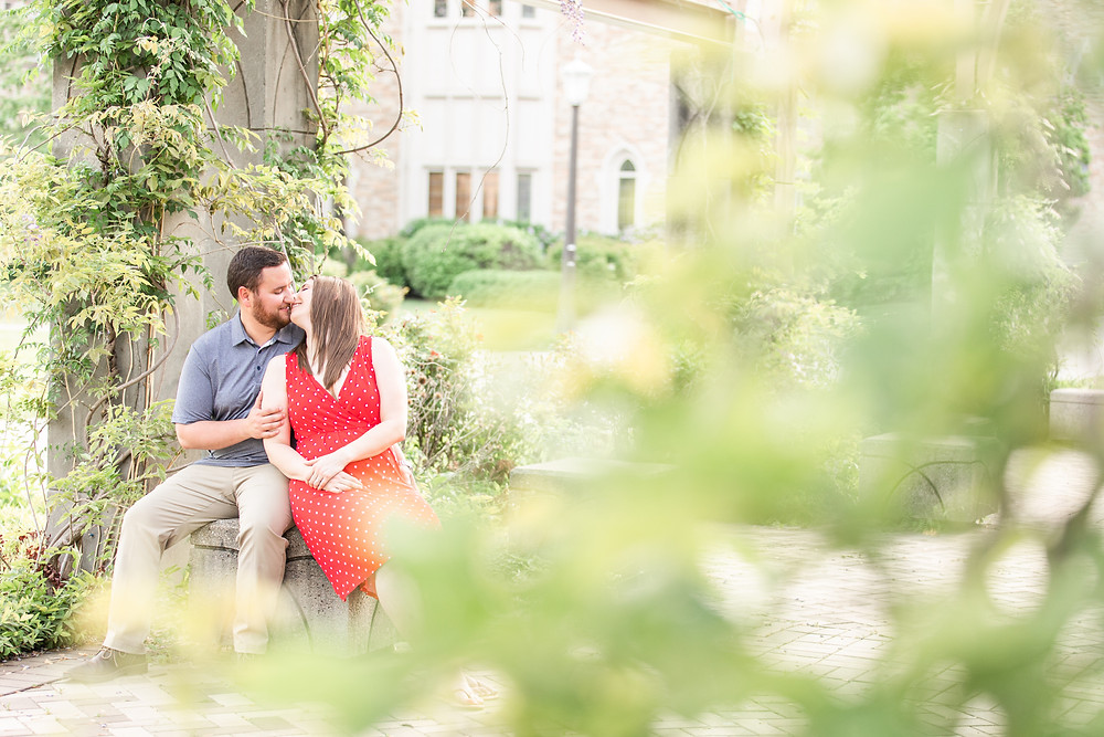 Josh and Andrea wedding photography husband and wife photographer team michigan pictures university notre dame engagement pictures session photo shoot fiance kissing sitting