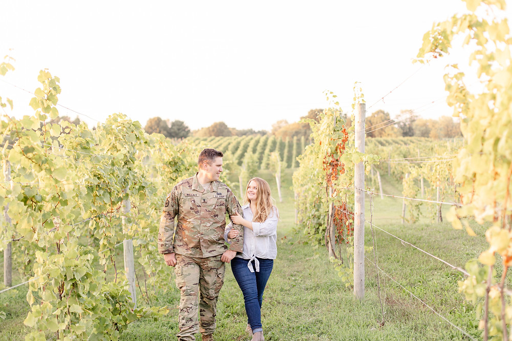 Engagement photos Round Barn Winery Baroda Michigan walking in vineyard cute couple