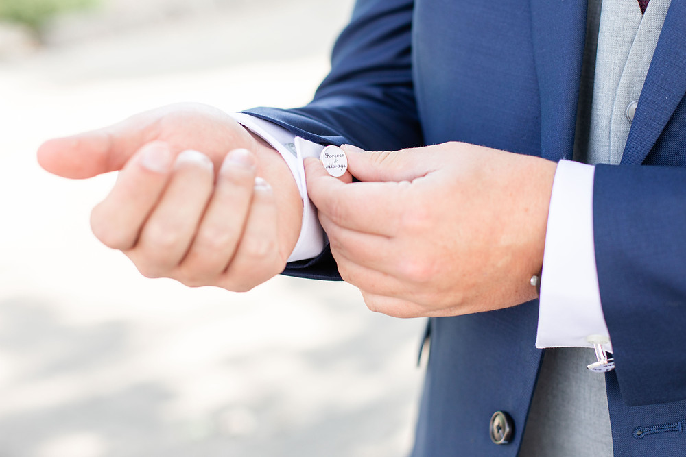 Josh and Andrea wedding photography husband and wife photographer team michigan details Jackson groom