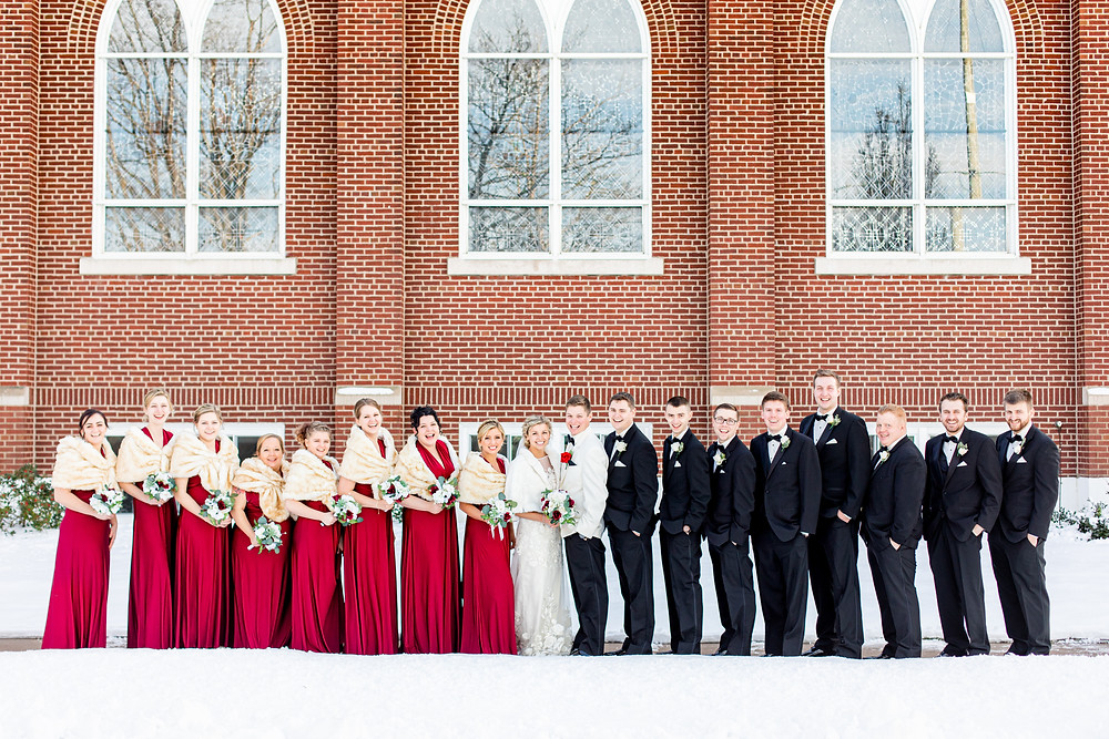 josh and Andrea photography husband and wife team michigan winter wedding south haven st basils bride and groom with bridal party