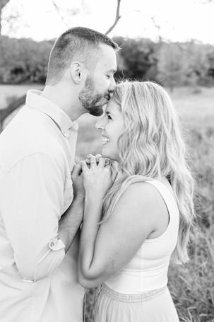 Engagement Photos Al Sabo Land Preserve Kalamazoo Michigan Open Field cute couple holding hands guy kissing girls forehead