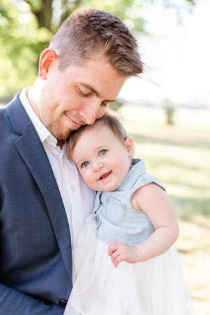 South Haven Michigan Cute Family Photo Session Dad holding little girl smiling