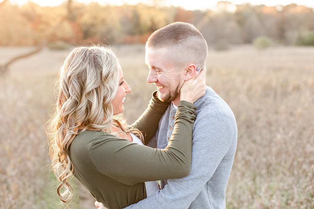 Josh and Andrea Photography engagement shoot Al Sabo cute couple standing smiling in field