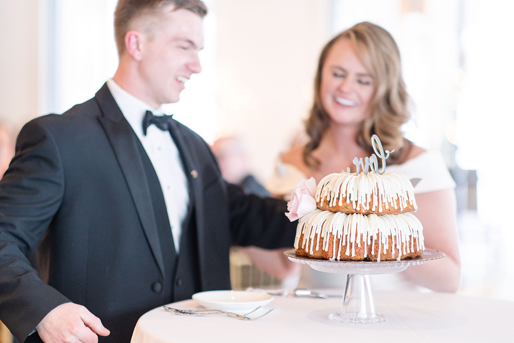 Josh and Andrea wedding photography husband and wife photographer team michigan venue Bay Pointe Woods shelbyville snow winter wedding reception cake shot