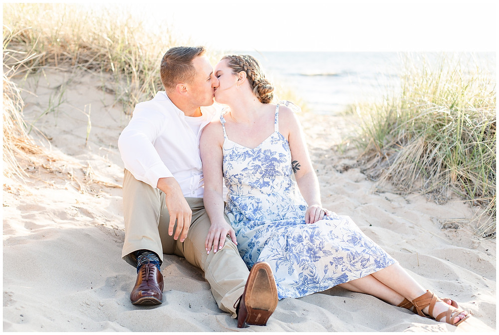 Josh and Andrea wedding photography husband and wife photographer team michigan pictures south haven engagement pictures session beach photo shoot fiance sitting kissing