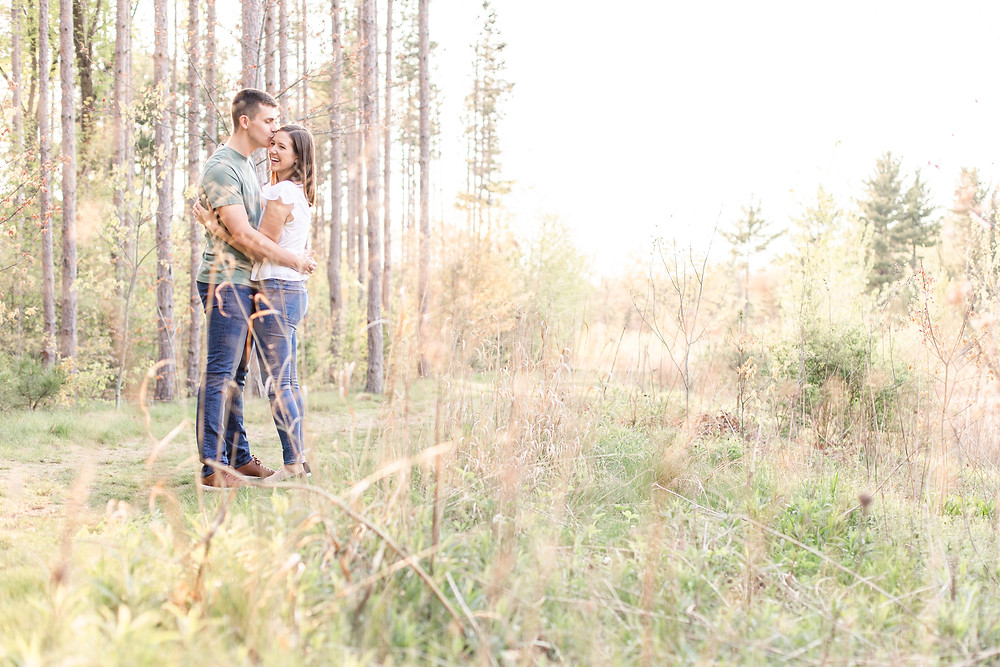 Josh and Andrea wedding photography husband and wife photographer team michigan engagement pictures session photo shoot fiance Riley Trails smiling standing