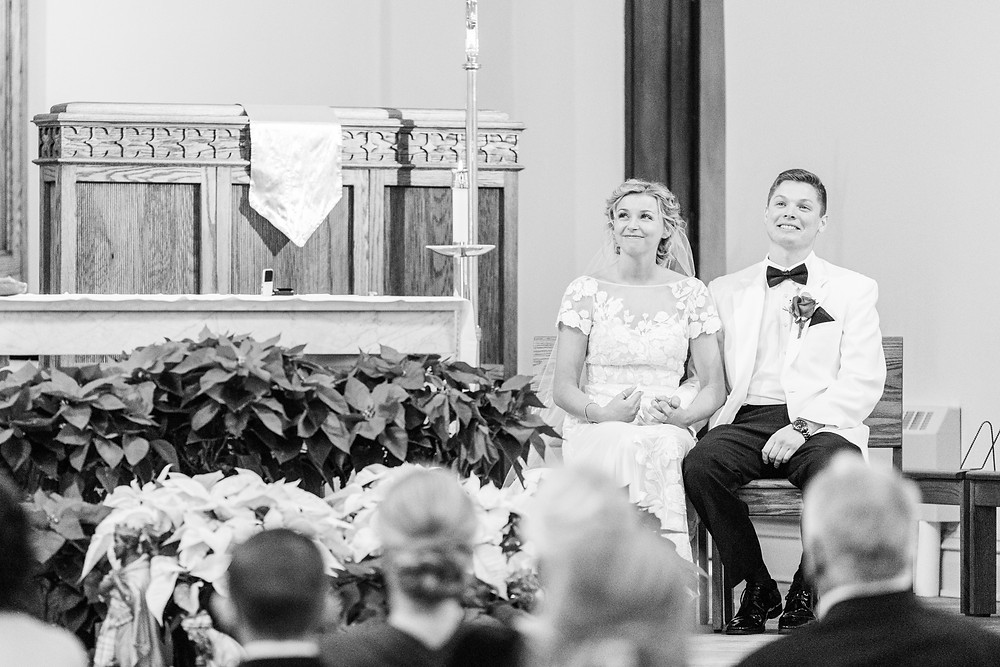 josh and Andrea photography husband and wife team michigan winter wedding south haven st basils bride and groom sitting at front of church