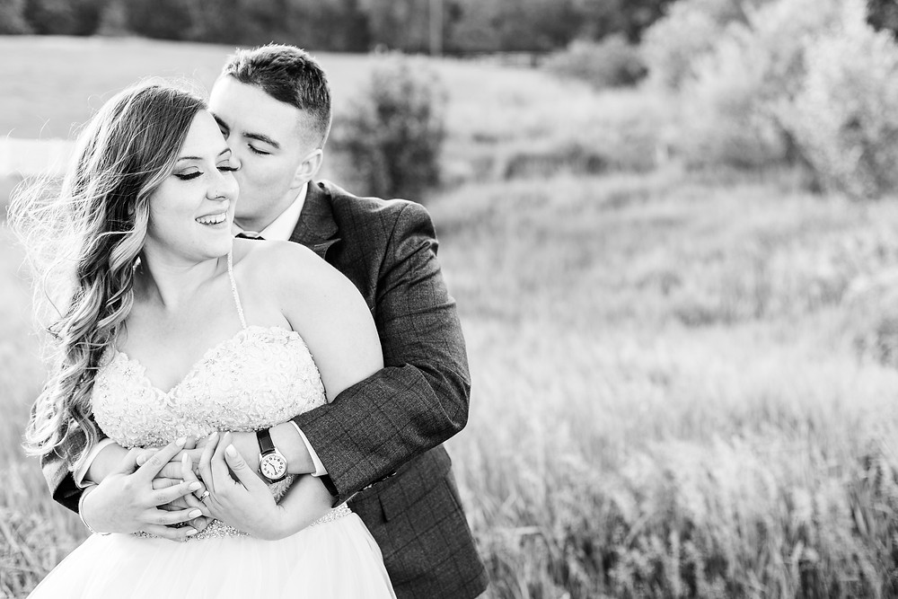 Josh and Andrea wedding photography husband and wife photographer team michigan pictures hydrangea blu barn bride and groom sunset kissing