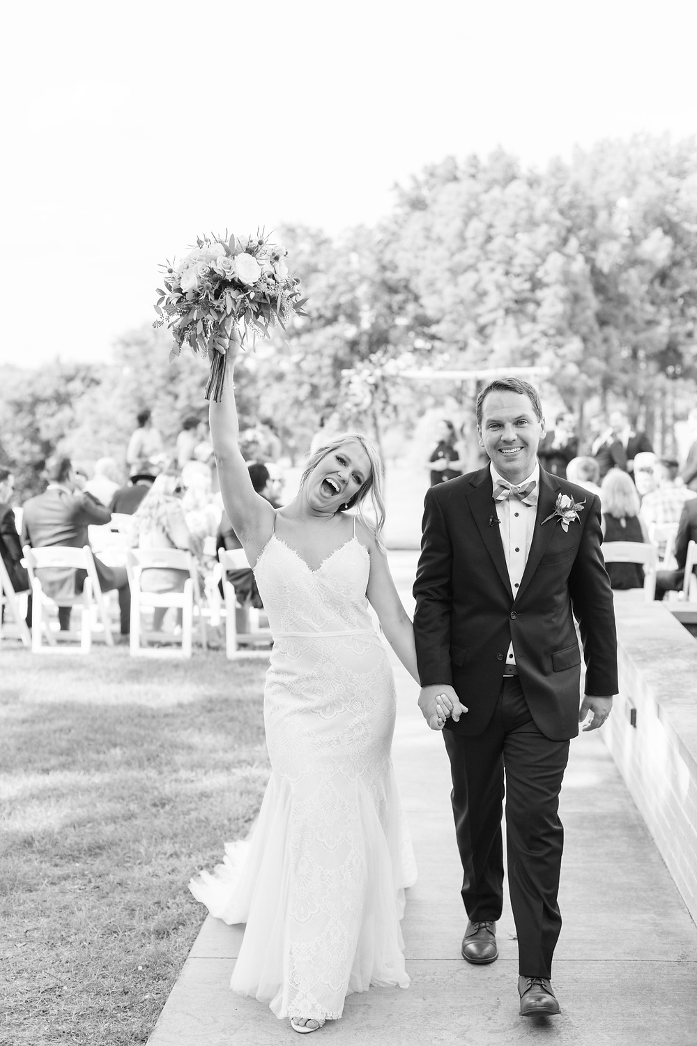 mr and mrs celebration walking down aisle ceremony Kent Country Club Wedding Grand Rapids