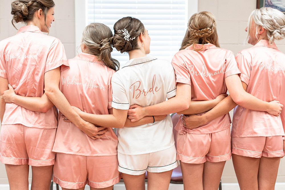 photo of back of Bride and Bridesmaids in matching pjs with names on back Milledgeville Georgia