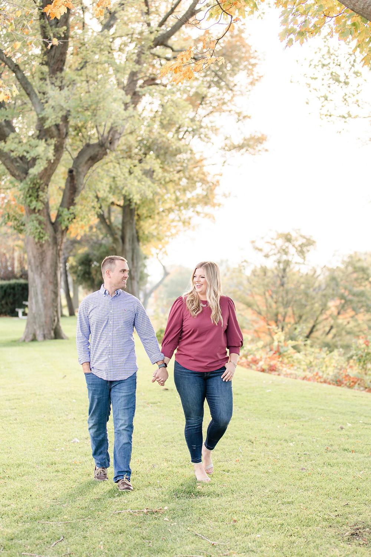 Engagement Photos Downtown Saint Joseph MI cute couple walking in park