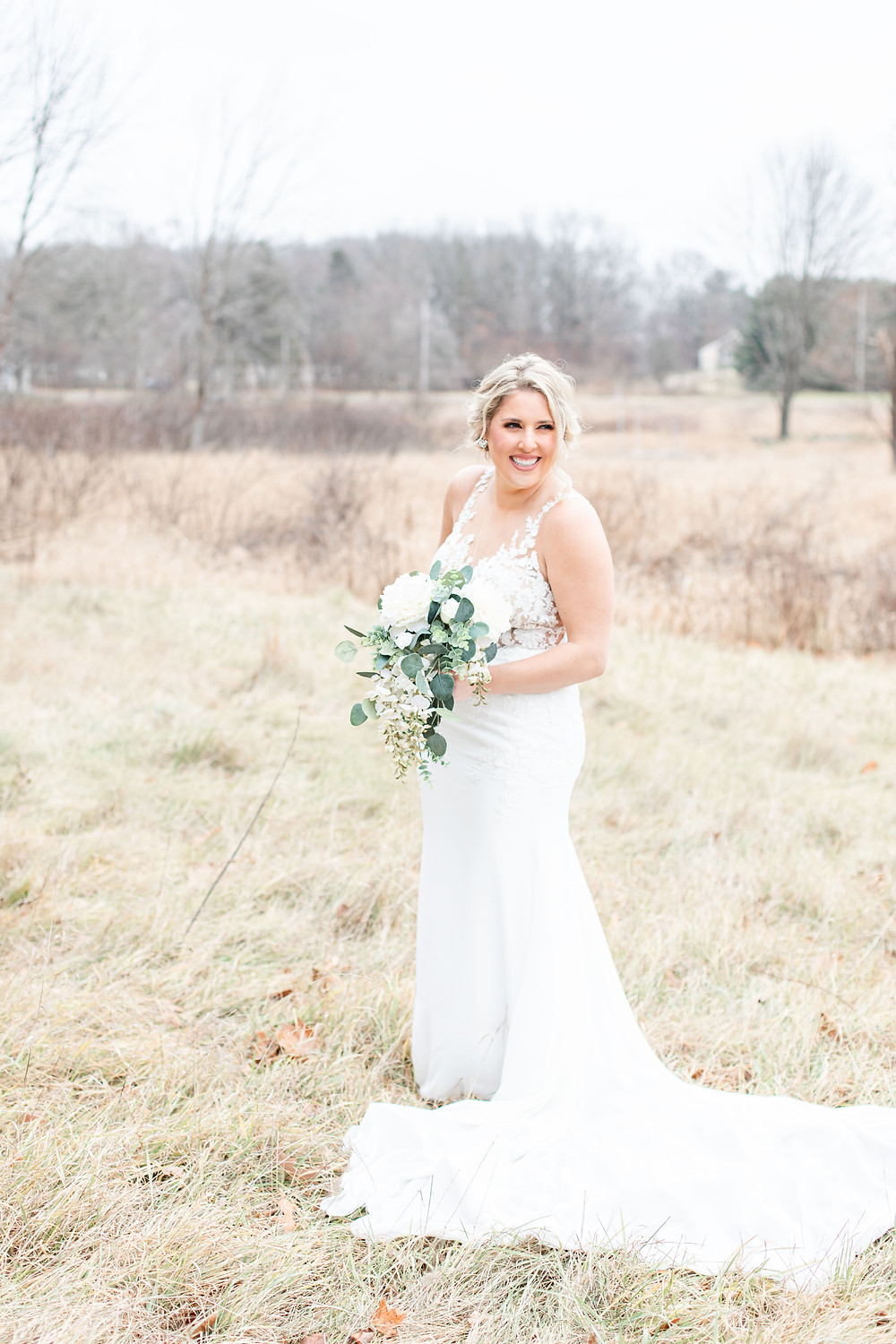 josh and Andrea photography husband and wife team michigan winter wedding bride bridal portrait