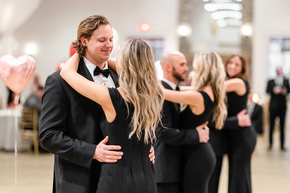Josh and Andrea wedding photography husband and wife photographer team michigan venue Bay Pointe Woods shelbyville snow winter wedding reception first dance