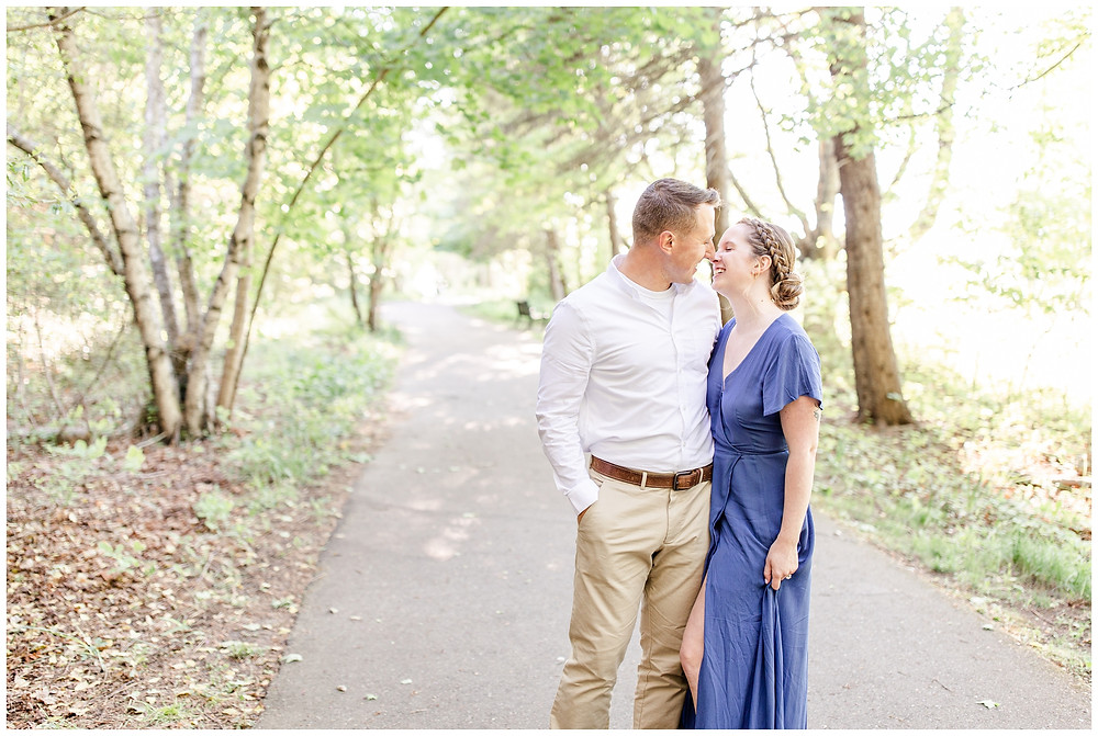 Josh and Andrea wedding photography husband and wife photographer team michigan pictures south haven engagement pictures session fields and woods photo shoot fiance kissing