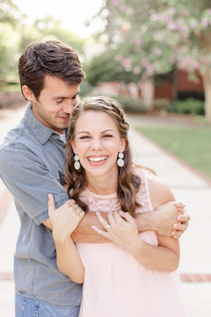 engagement photos cute couple hugging laughing Milledgeville GA Georgia College and State University