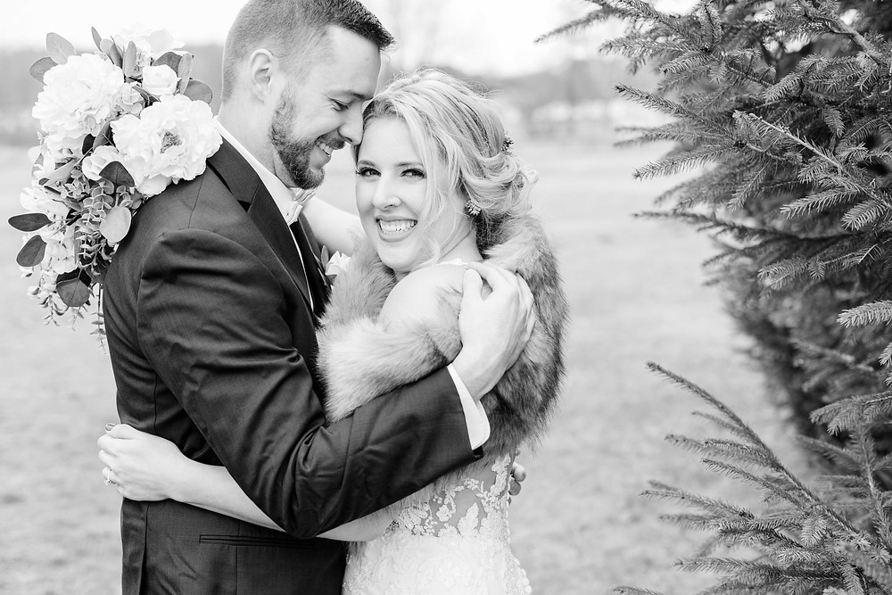 josh and Andrea photography husband and wife team michigan winter wedding bride and groom smiling