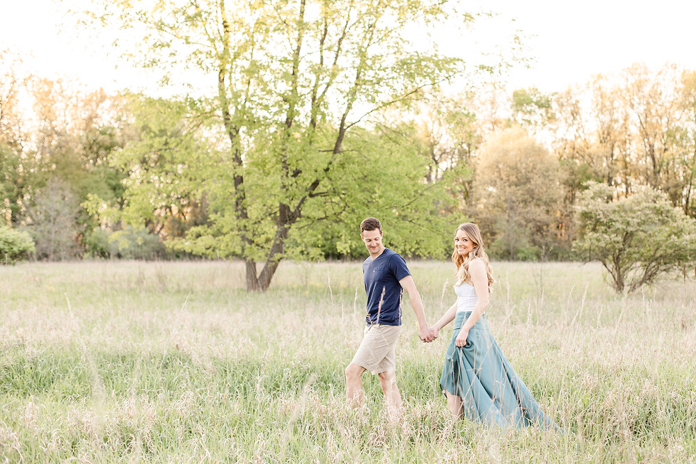 Josh and Andrea wedding photography husband and wife photographer team michigan Al Sabo Land Preserve engagement pictures session photo shoot fiance woods field walking smiling