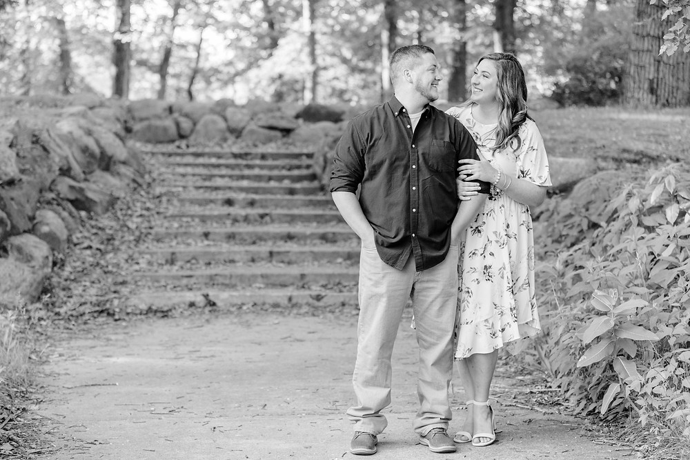 engagement photos cute couple standing near stone steps at milham park kalamazoo michigan